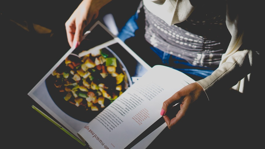Cookbook on woman's lap