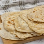 Tortilla Shells on a bamboo cutting board with title overlay