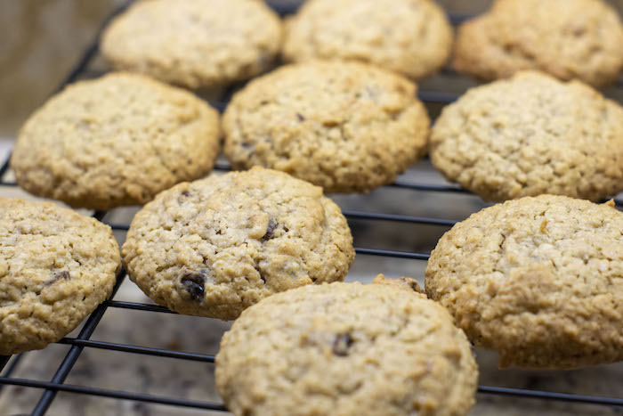 Oatmeal Raisin Cookies cooling on a wire rack over a granite surface