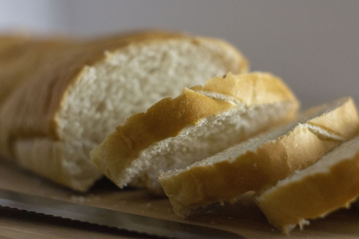 Closeup of a loaf of bread with a few slices cut off of it