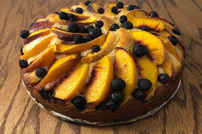Peach and Blueberry Cake on a wooden surface