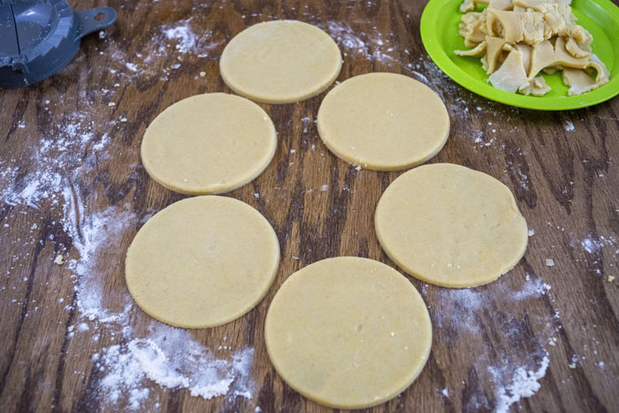 Round cookie dough on a wooden background