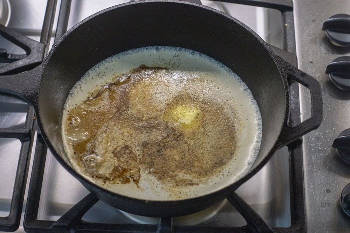 Cream ingredients in the cast iron skillet over a gas stovetop