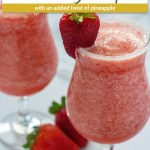 Two Strawberry Pineapple Daiquiri's in a glass cup rimmed with sugar and garnished with a strawberry (with title overlay)