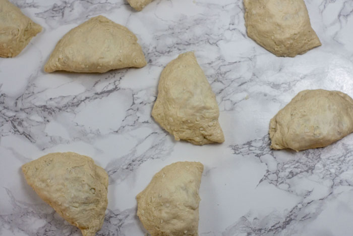 Closed chicken biscuits on a white and grey marble surface