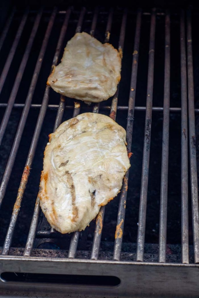 Chicken breast cooking on a grill