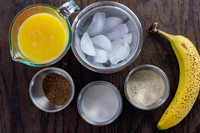 Dreamsicle Protein Smoothie Ingredients: orange juice, ice, banana, protein powder, coffee cream, flaxseed