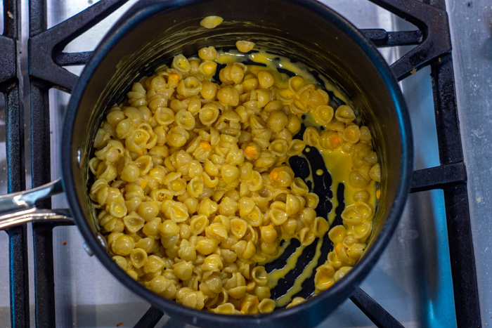 Mac and cheese in a pot on a gas stovetop