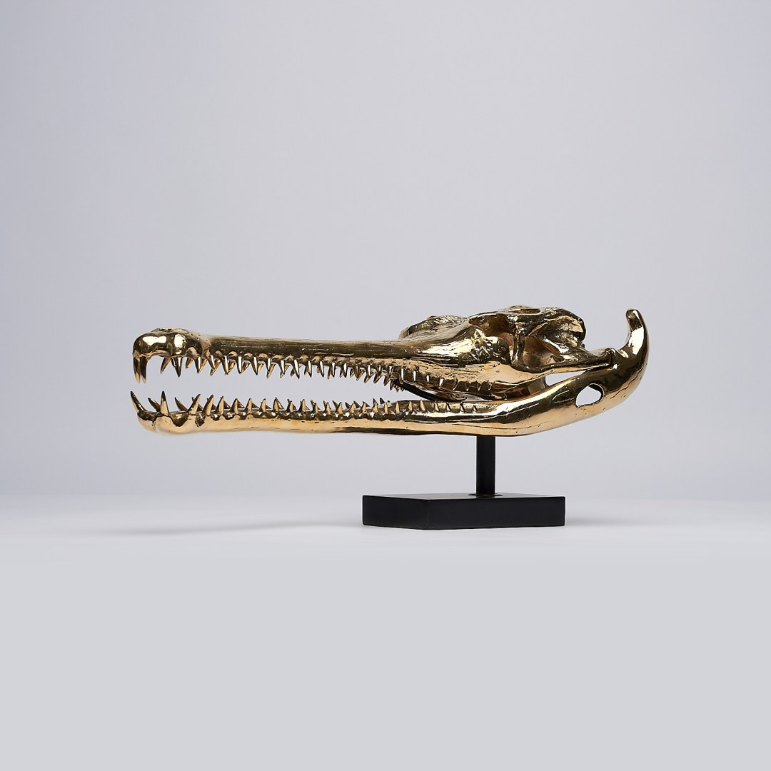 polished bronze gharial sculpture