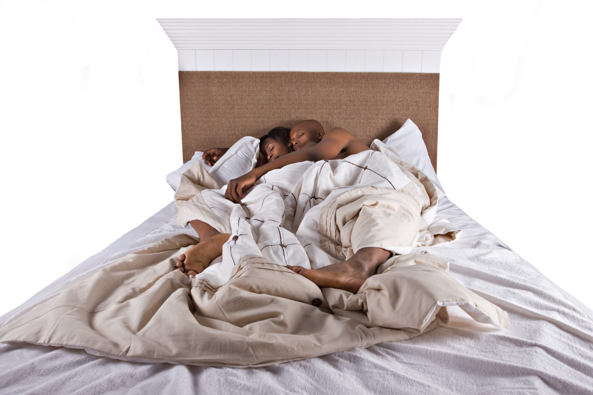 4118329 – african american couple in bed sleeping