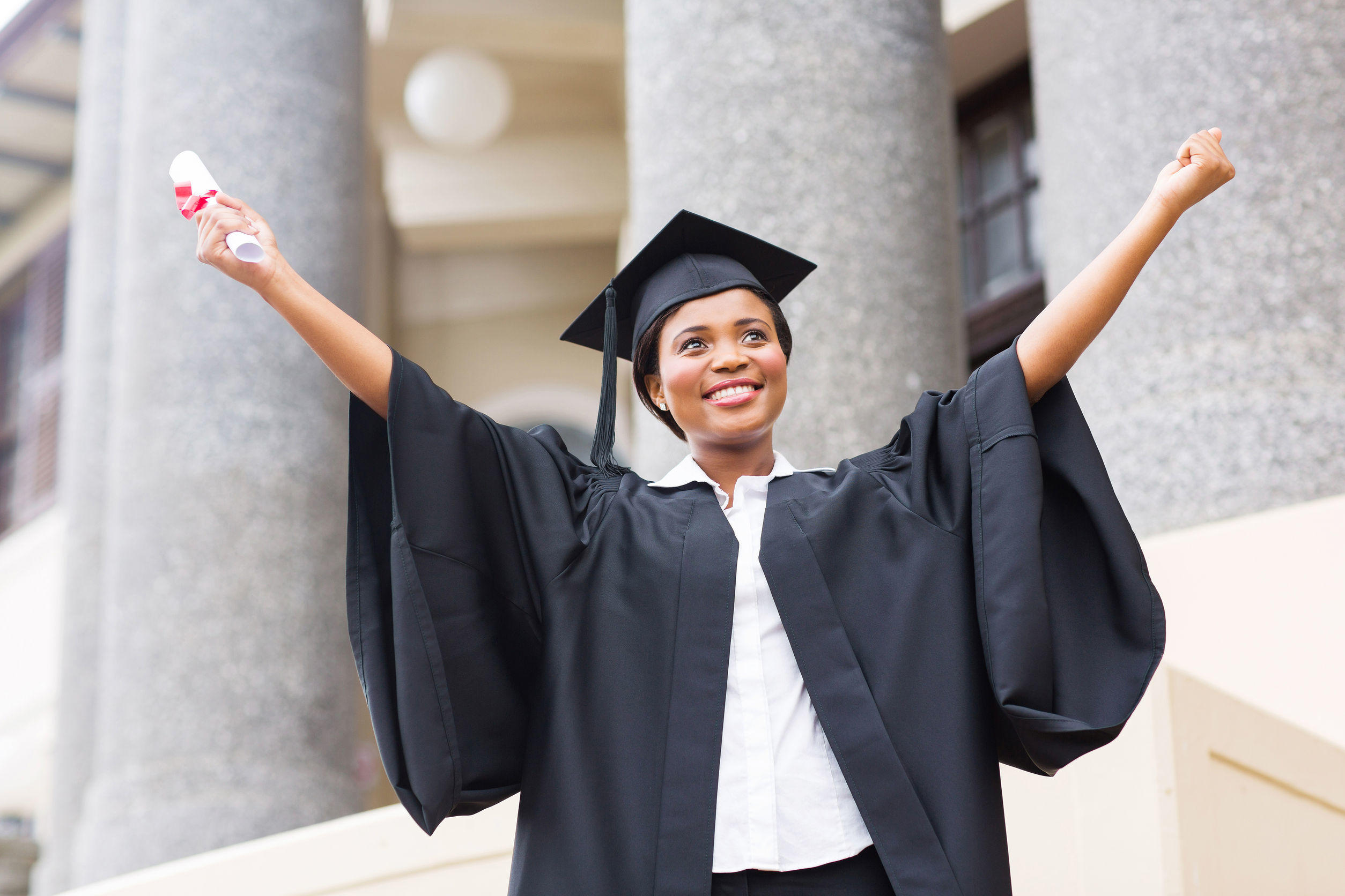 26458463 – happy african american female student with diploma at graduation