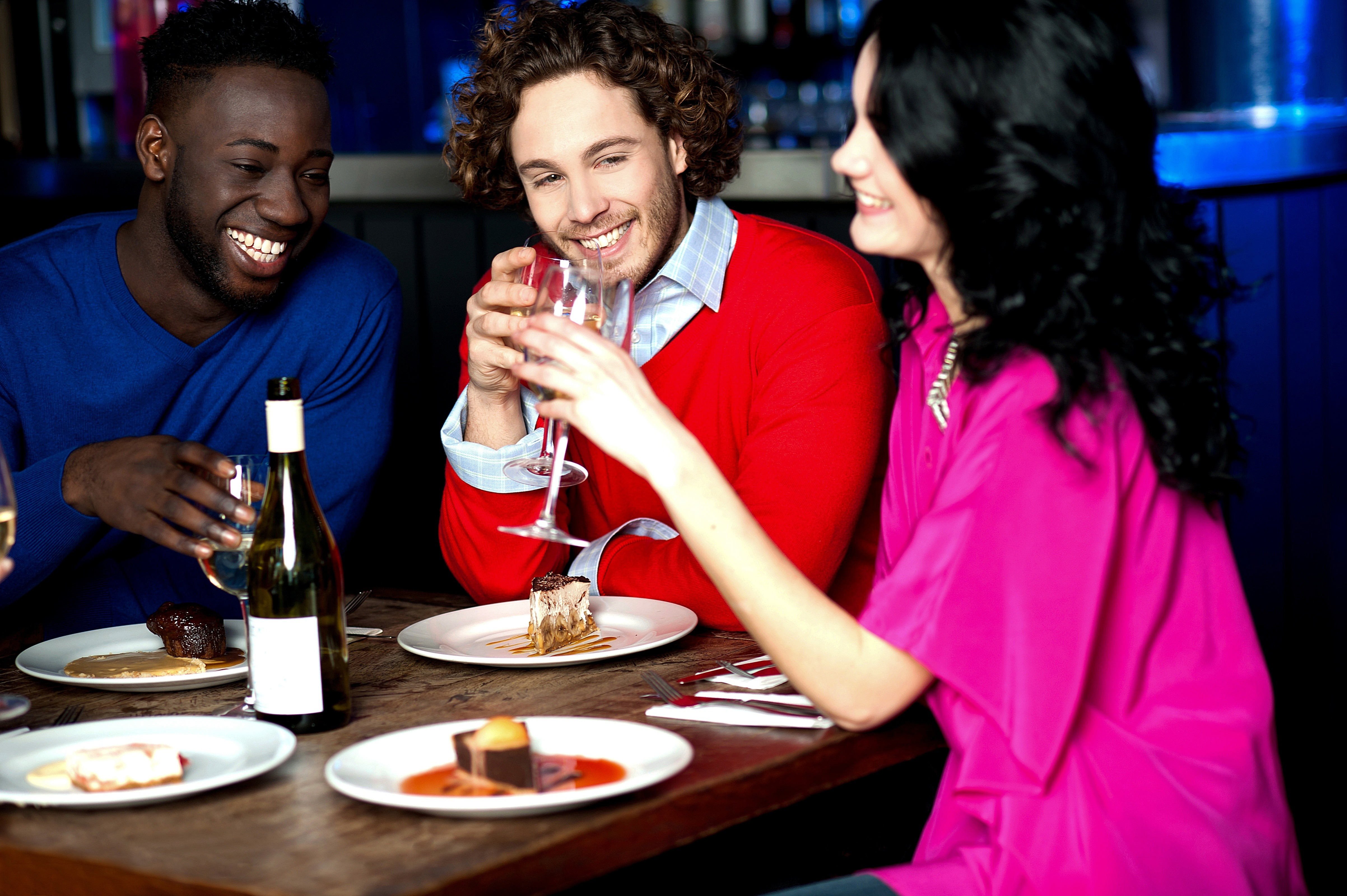 21537700 – friends having their dinner with drinks at a restaurant