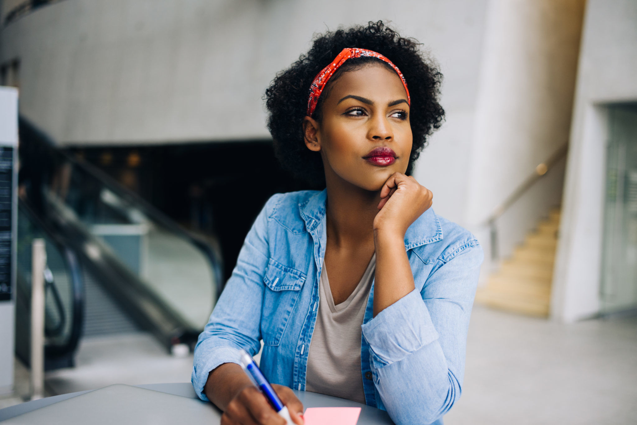Focused young African female entrepreneur thinking up new busine