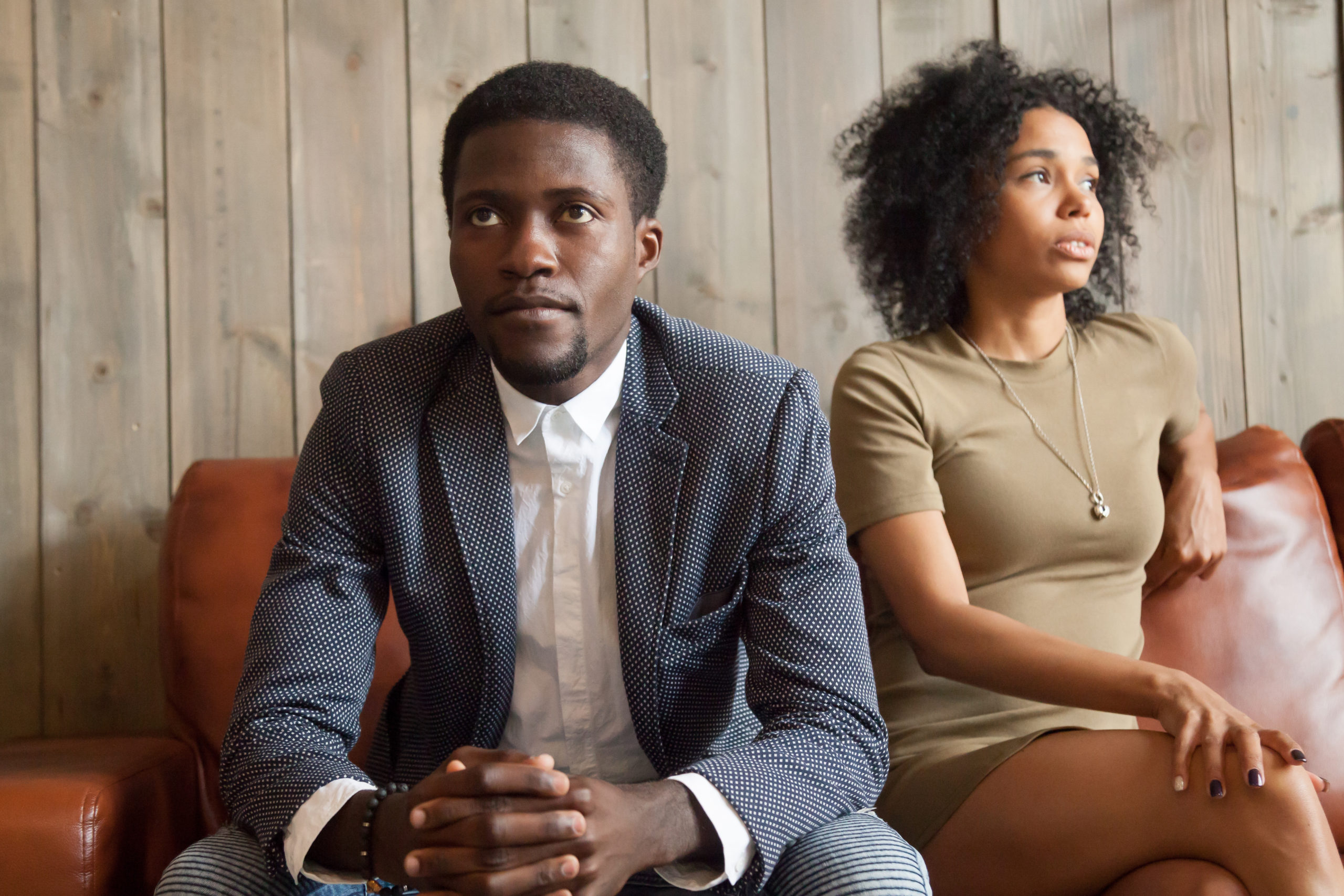 Frustrated upset african couple in quarrel not talking after fig