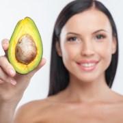 Woman holding avocado