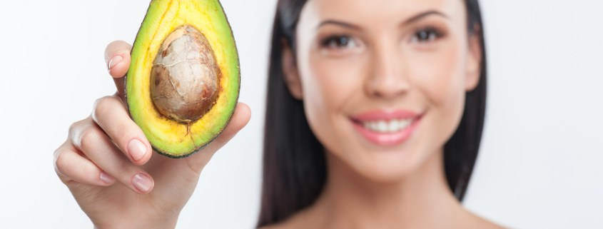 Woman holding avocado
