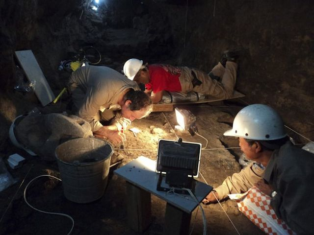 Handout photo INAH archaeologists working at a tunnel that may lead to a royal tombs discovered at the ancient city of Teotihuacan