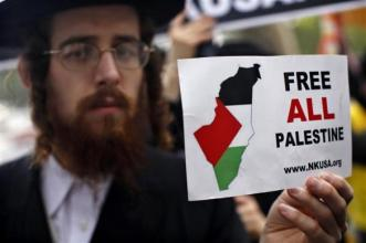 A Jewish man holds a sign during a protest against the Israeli government as they demand for the recognition of Palestinian statehood in New York