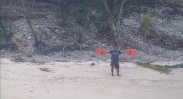 Rescatan a náufragos gracias a mensaje de 'ayuda' sobre la arena