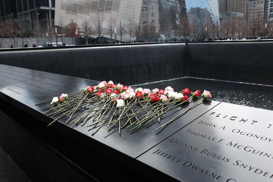 NEW YORK, NY - FEBRUARY 26: Flowers are viewed at one of the reflecting pools at Ground Zero with the names of those killed in the 1993 World Trade Center bombing that killed six people and injured more than 1,000, on February 26, 2015 in New York City. Officials at the September 11 museum held a small memorial service with family members of the deceased to mark the 22nd anniversary of the 1993 bombing. The north pool of the September 11 memorial is where a truck bomb exploded below the trade center?s north tower on Feb. 26 of 1993. (Photo by Spencer Platt/Getty Images)