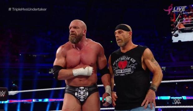 Triple H y Shawn Michales derrotaron a The Undertaker y Kane