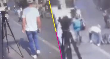 Qué poca... Captan a sujeto 'robando' a un herido en balacera en Cuernavaca