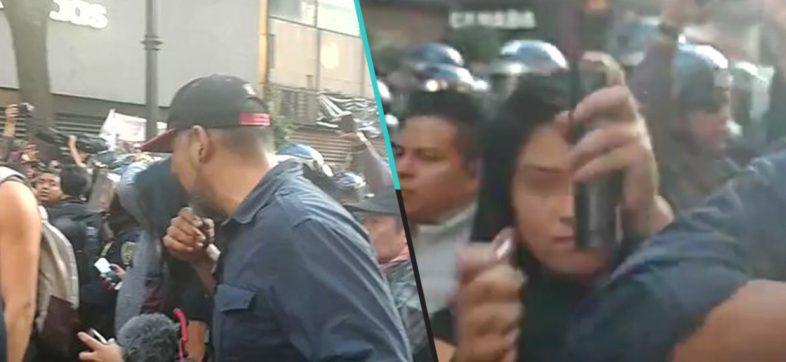 ¿Por? Mujer es captada intentando prender fuego a reportero durante marcha del 2 de octubre