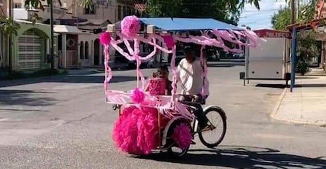 Un vendedor de raspados pasea a su hija quinceañera en su triciclo adornado de color rosa