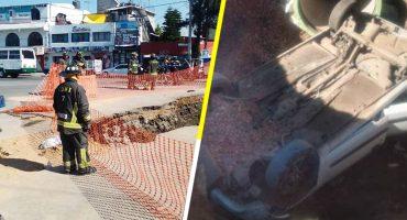 Socavón aparece en la alcaldía Tláhuac; dos personas que viajaban en automóvil resultan heridas