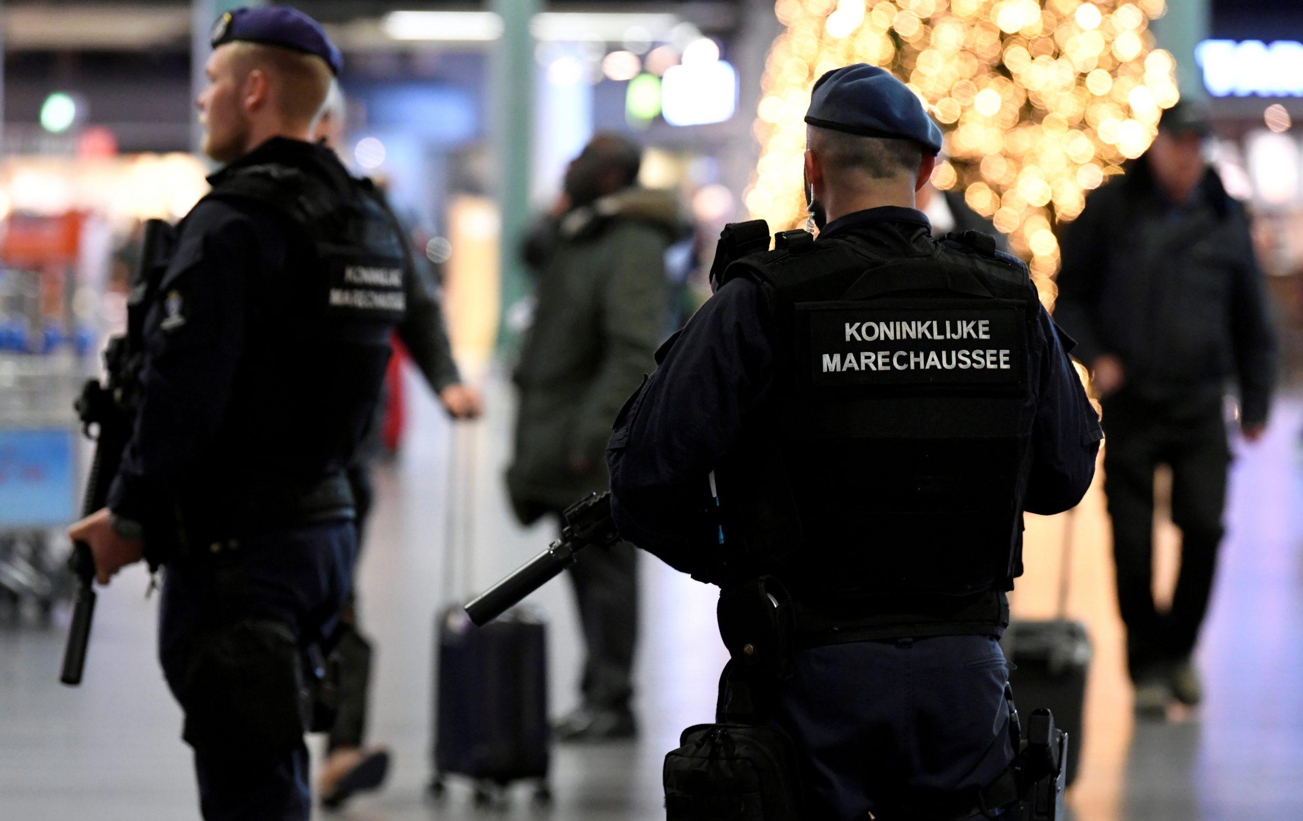 FILE PHOTO: Dutch police patrol at Amsterdam's Schiphol airport, November 6, 2019.