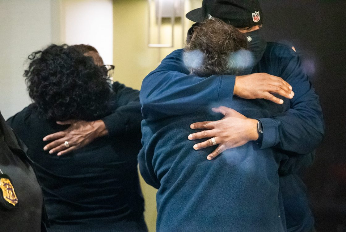 People hug after learning that their loved one is safe after a person shot and killed 8 people inside a FedEx building Friday, April 16, 2021.Fedex Mass Shooting Indianapolis Indystar