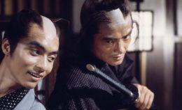 Hanjiro (Ken Ogata) confides in Okita (Teruhiko Saigo)