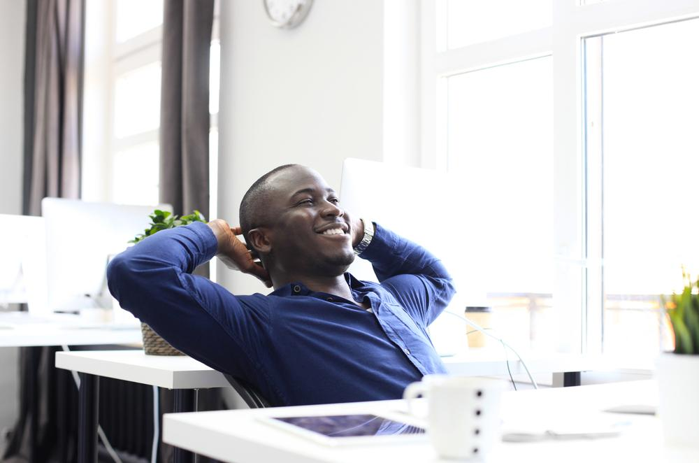 Man looking relaxed because he has job security