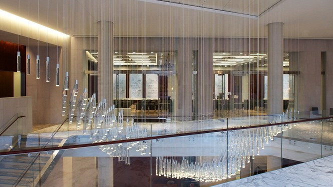 A Series Of Pendants Form Cloud Lights When Seen From Across The Lobby