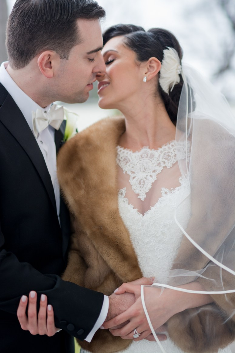 Stylish NY Bride and Groom Bride wearing faux fur bolero