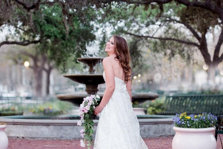 Stylish Bride Portrait Standing Near Fountain
