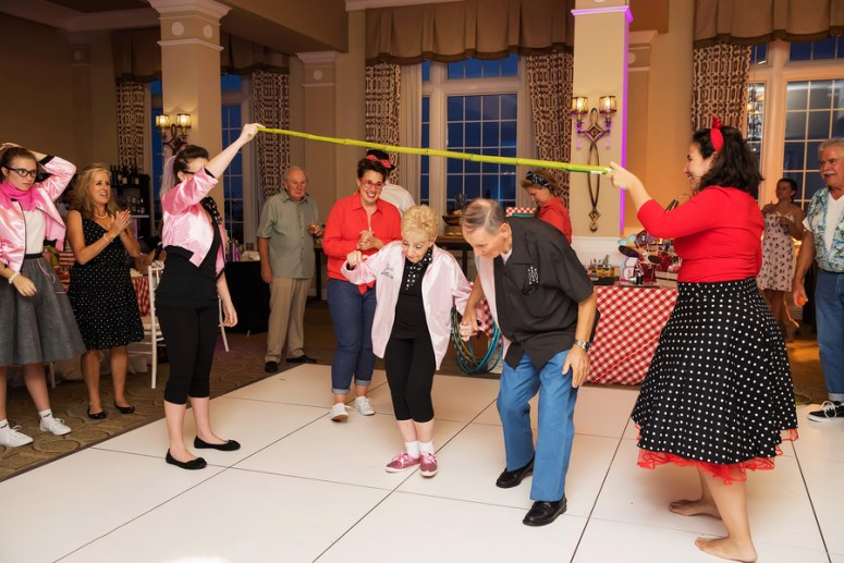 Doing the limbo at a wedding anniversary