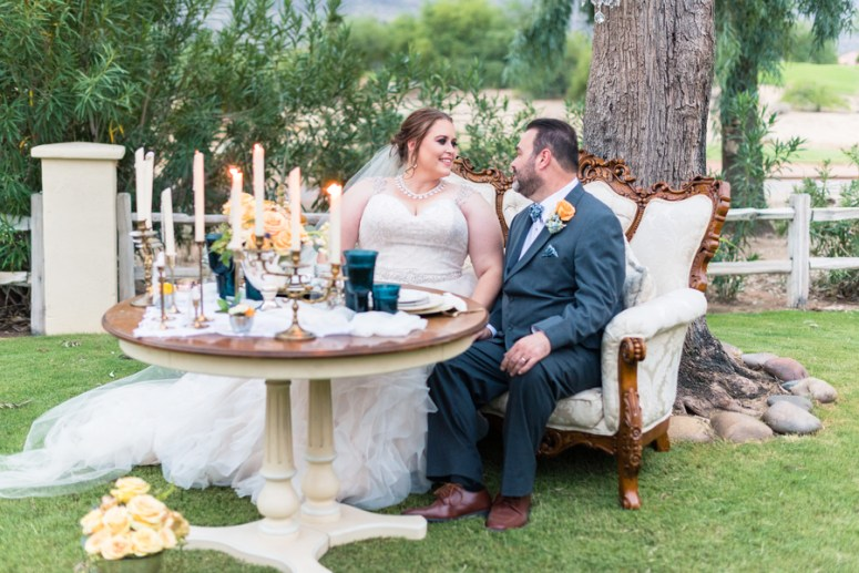 Bride & Groom at Sweetheart table with couch