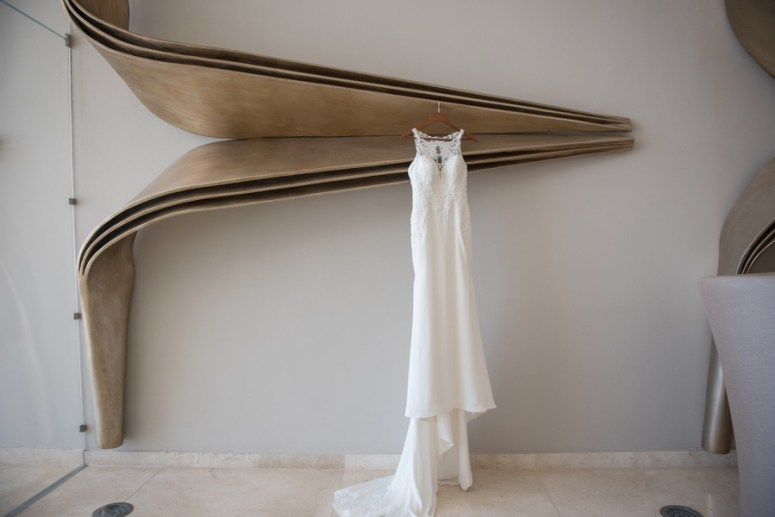 Wedding gown hanging in bridal suite