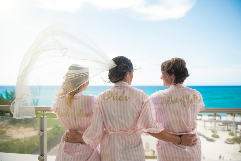 Bride and bridesmaids in striped robes