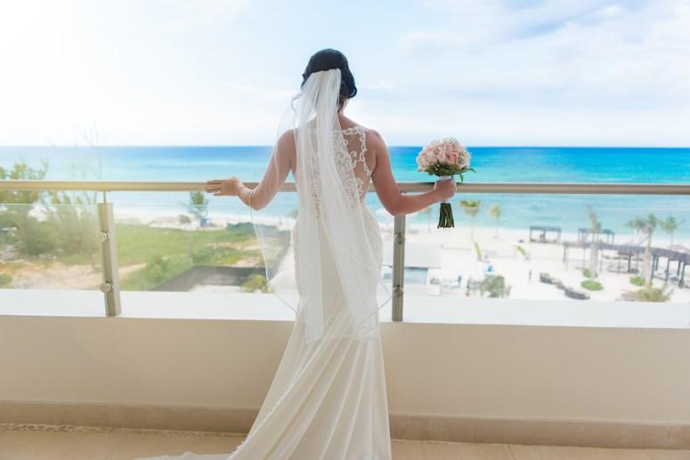 Bride overlooking the ocean