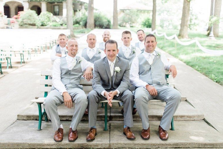 Groom and Groomsmen Sitting in Bleachers