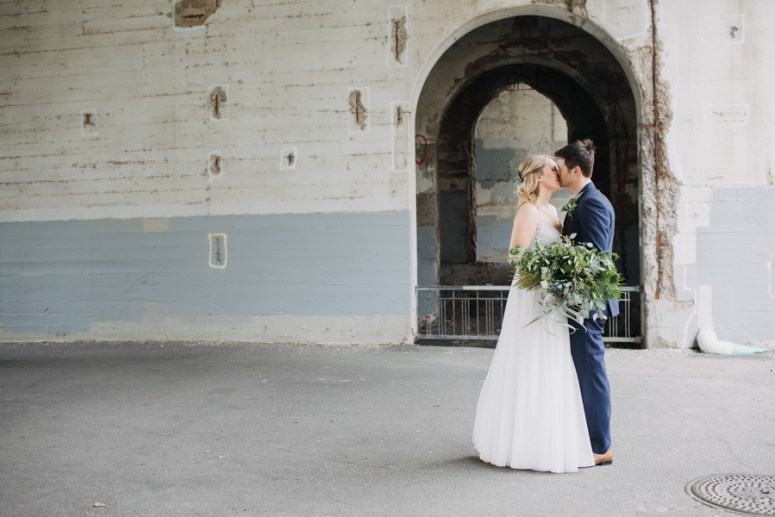 bride and groom kiss bridal portraits