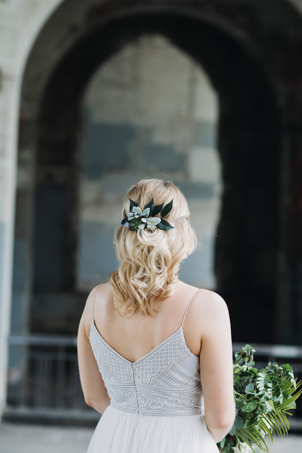 bridal hairstyle with floral accent