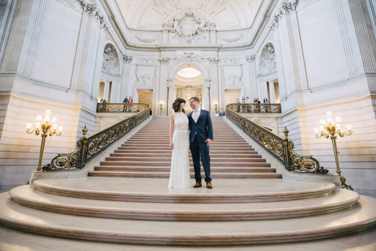 Bride and Groom on standing steps of San Francisco City Hall