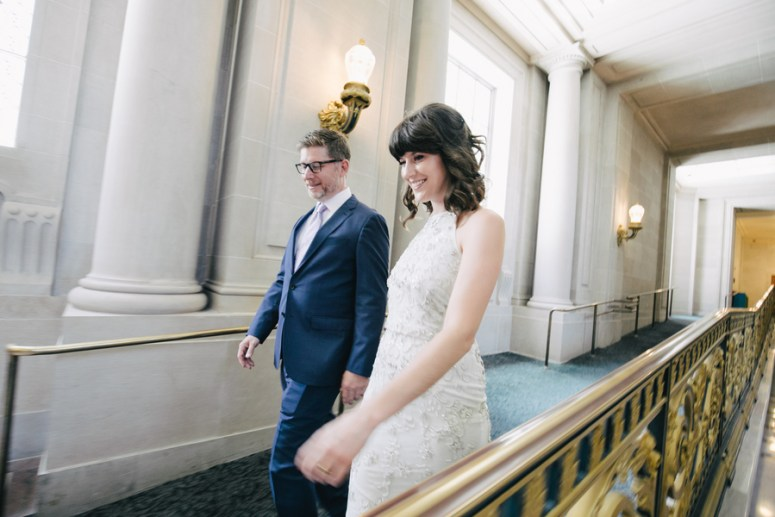 Bride and Groom walking to wedding ceremony in city hall