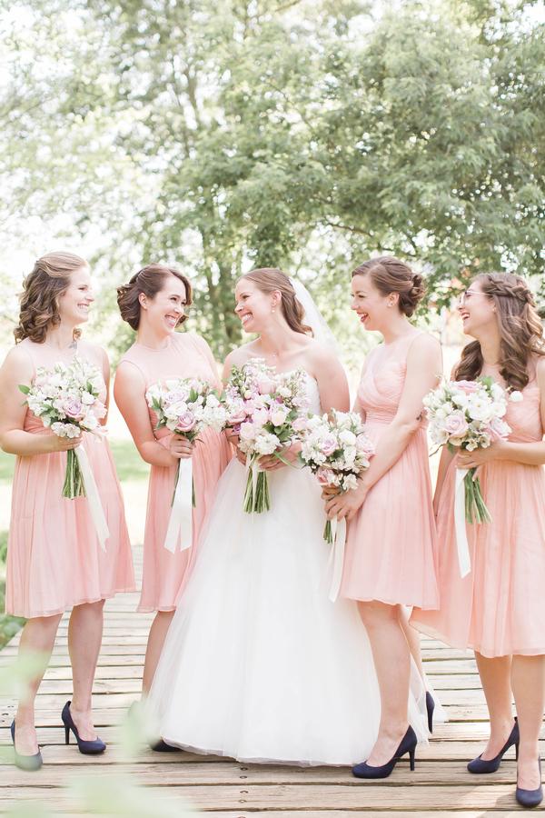 bridesmaids wearing blush and navy