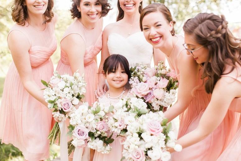 bridesmaids wearing blush gowns