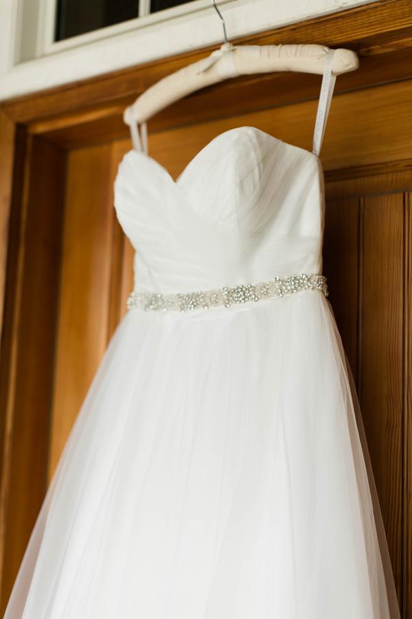 wedding dress on hanger before ceremony