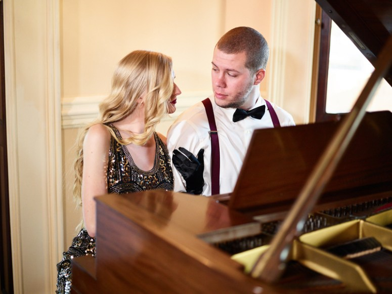 couple sitting at piano